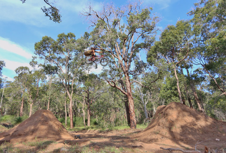 Tim Rose boosting dirt jumps