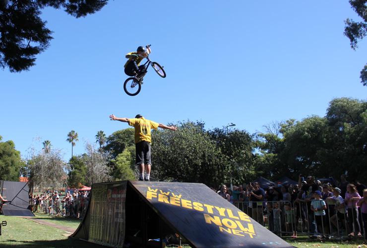 Freestyle Now bmx stunt show - Dylan Schmidt over Shaun Jarvis  - John Hughes slopestyle