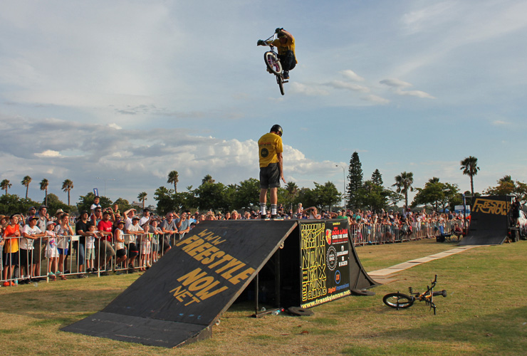 Freestyle Now bmx stunt show - Australia day 2016 Dylan Schmidt jumps over Shaun Jarvis